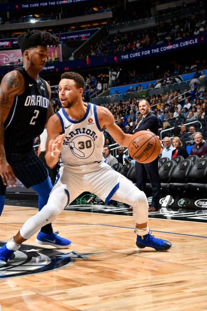 Stephen Curry of the Golden State Warriors handles the ball against the Orlando Magic on December 1 2017 at Amway Center in Orlando Florida NOTE TO...