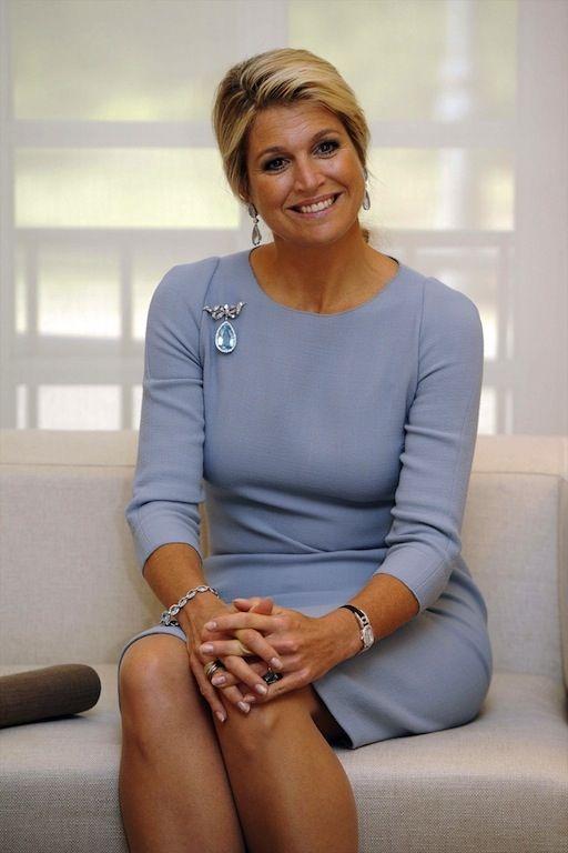 Máxima looking happy in a Natan dress