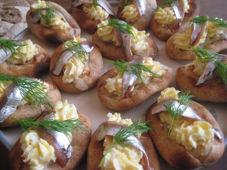 Coctail Karelian pies with egg butter and anchovy