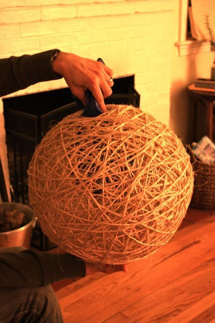 Make with yarn and glue around large balloon for entry light