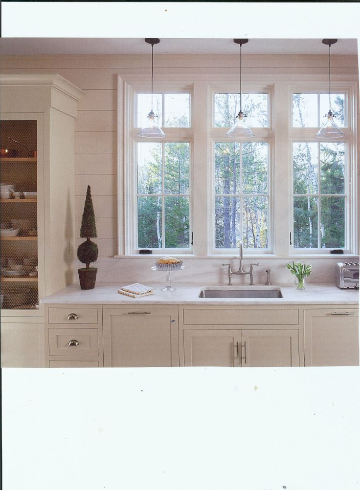 Love the horizontal paneling in this Portland kitchen and I like the  backsplash out of the