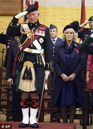 Prince Charles and Camilla attend a ceremony at the Black Watch Regiment