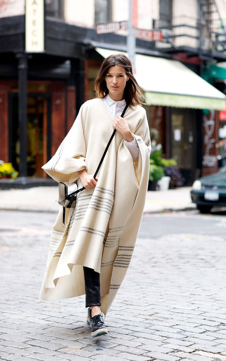 Vogue.com Contributing Photographer Hanneli Mustaparta demonstrates how to wear fall's oversize but romantic incarnations of the poncho.