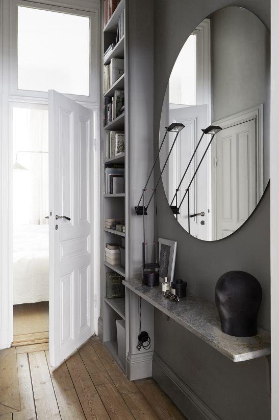 Birkagatan josefin hååg fantastic frank round mirror grey wooden floor red wood hallway