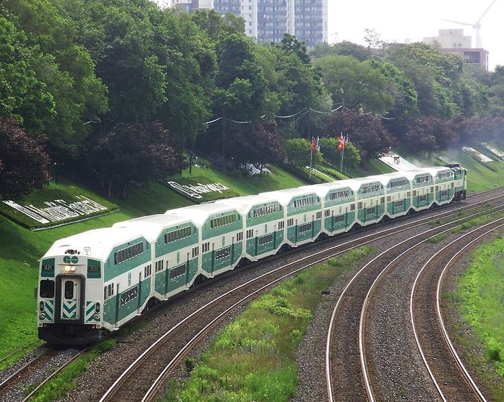 A GO Transit commuter train on the Lakeshore West line in Toronto, Canada, travelling westbound to Burlington. Photograph was taken looking east from the Roncesvalles Avenue pedestrian bridge. Date 3 July 2008