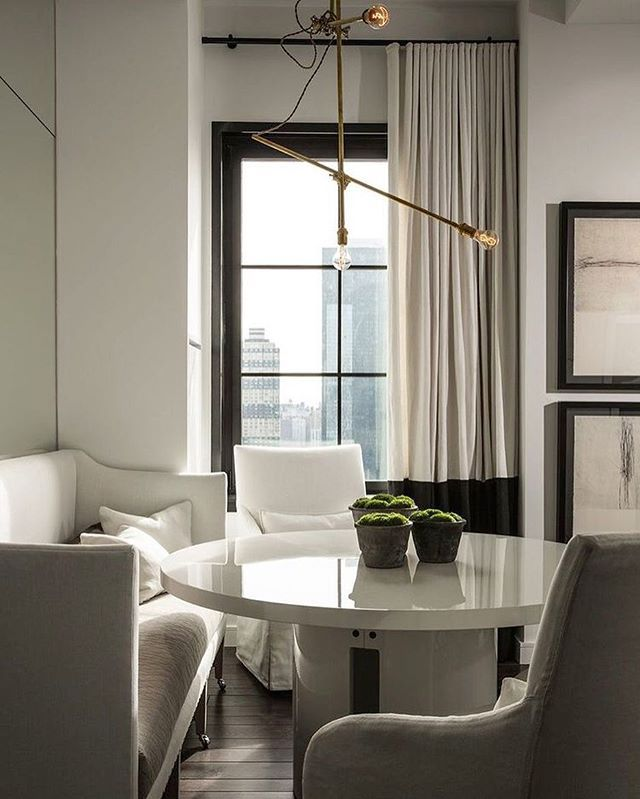 Monday is half way over! Hoping the sublime Stella Tower in NYC by @michaeldawkinshome gets you through the rest of today. It certainly is a stunner! #michaeldawkinshome #nyc #stellatower #interiors #inspiration #design #interiordesign #aesthetic #moody #sophisticated #elegant #gorgeous #layers #monochrome #dining #home #white #lighting #brass
