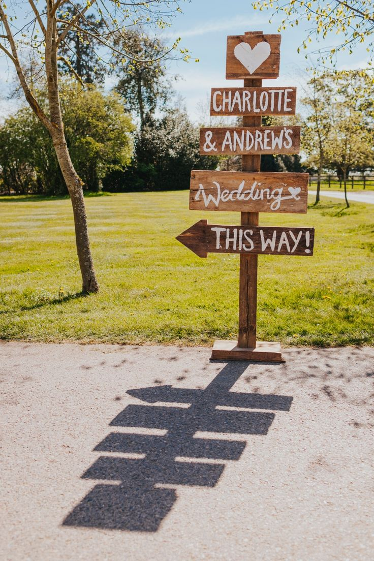Make sure you point your guests in the right direction to get to your wedding! Sign by the very talented @lauralulabee. Photo by Benjamin Stuart Photography #weddingphotography #lulabee #weddingsign #woodensign #weddingideas