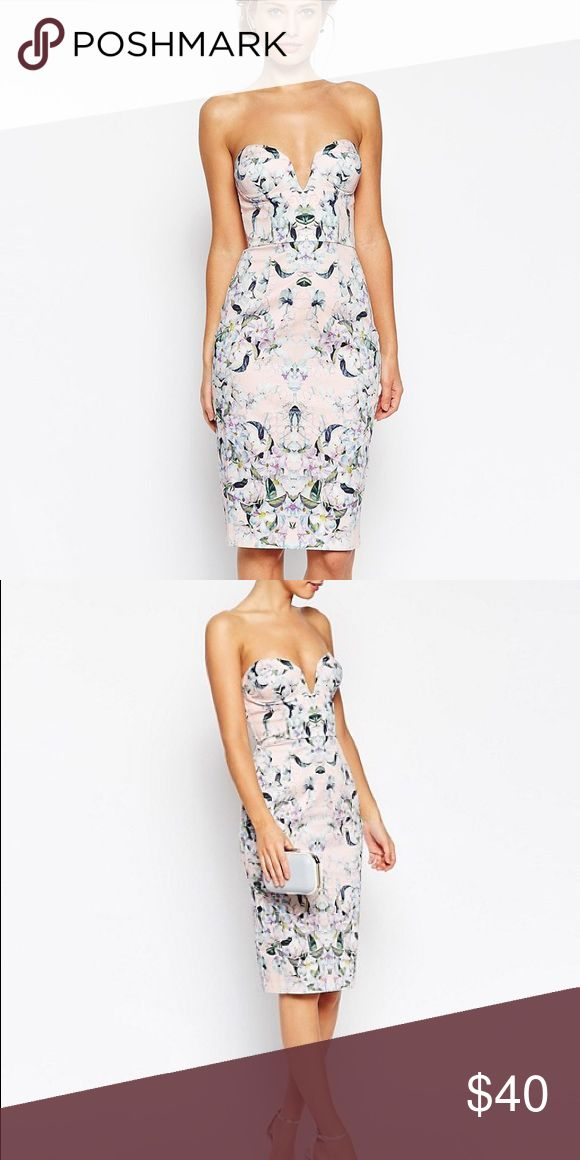 ASOS Petite Pencil Floral Curved Plunge Neck Dress Lightweight firm-stretch cotton. Slightly silky finish. Plunge sweetheart neckline. Moulded, padded cups. Stretch band to the backZip back, hook and eye fastening. Close cut bodycon fit. Machine wash. 97% Cotton, 3% Elastane. ASOS Petite Dresses Midi
