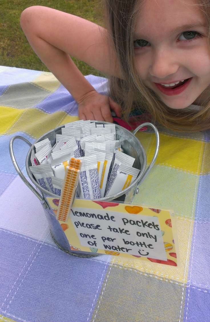 Lemonade stand for kids with water bottles and lemonade packets! Super easy