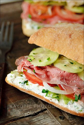 Pastrami Sandwich - ricotta cheese mixed with fresh herbs, cucumbers, onions, and tomato add a new twist to pastrami.
