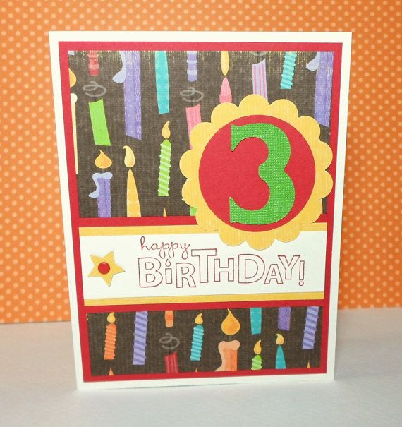 This handmade card features a glitter number 3 on fun birthday themed designer paper. Perfect kids 3rd birthday card. This card measures 5 1/2 x 4