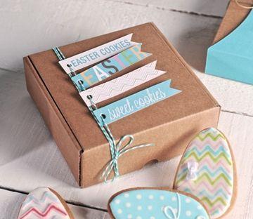 Packaging con caja kraft, hilo de algodón trenzado de dobre color y etiquetas.