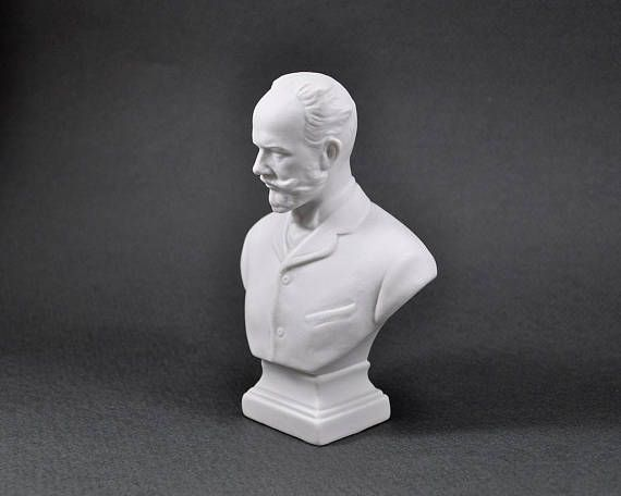 Miniature Porcelain Bust of a Great Russian Composer Pyotr Ilyich Tchaikovsky. Using porcelain bust of a famous composer as a decorative element instantly adds elegance, sophistication, and a classical touch to any interior. Pyotr Tchaikovsky was a famous Russian composer of the romantic period, some of whose works are among the most popular music in the classical repertoire.  The porcelain figurine was produced by Lomonosov Porcelain Factory LFZ in 1960s. There are two marks on the bottom…