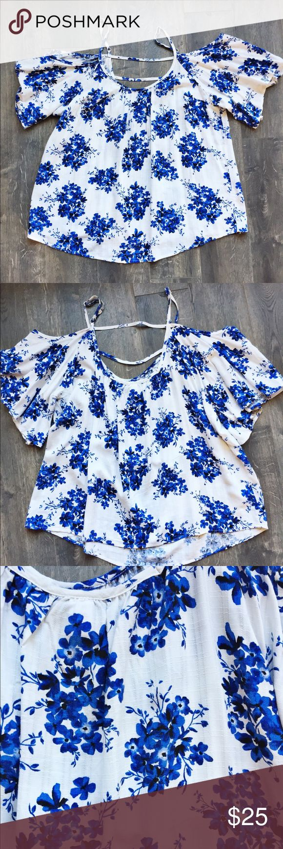 Torrid Top Blue and white short sleeve Torrid top. Cute with a white, or black bandeau/bralette underneath. Cute flirty back straps and adjustable shoulder straps. Worn twice. torrid Tops Blouses
