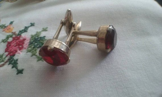 Check out this item in my Etsy shop https://www.etsy.com/au/listing/480966829/vintage-ruby-red-gold-tone-cufflinks