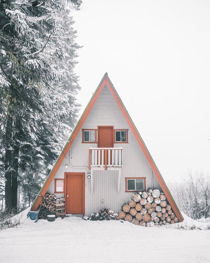 Snowy mountain A-frame cabin.