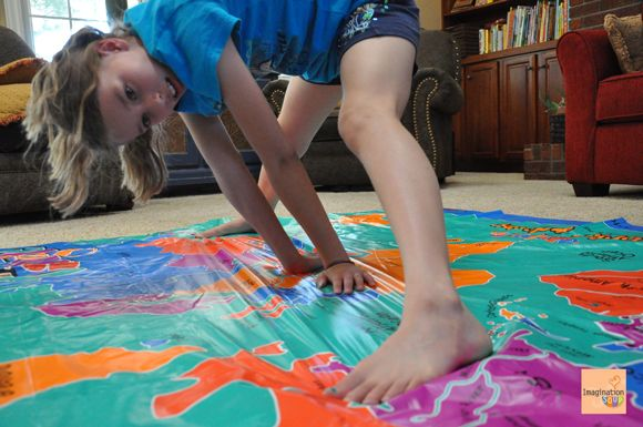 Kids can stretch both their bodies and their minds while they play Twister on a map of the world!