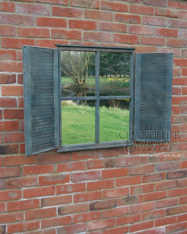 find a pair of old shutters and an old window and replace the glass with a mirror to reflect all the beauty in your garden. Great for a small garden or to lighten a dark corner