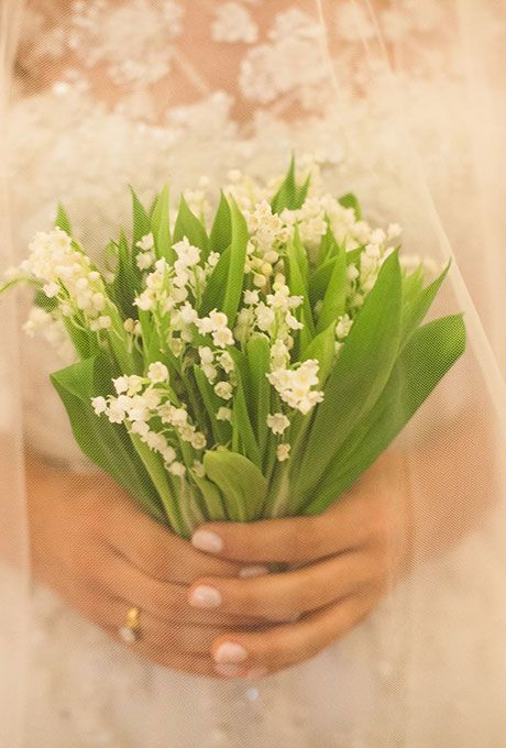 Brides.com: . This classic Lily of the Valley bouquet, created by The Vine Garden Market, was just the right arrangement for Elizabeth to carry down the aisle at her Sea Island, Georgia wedding.
