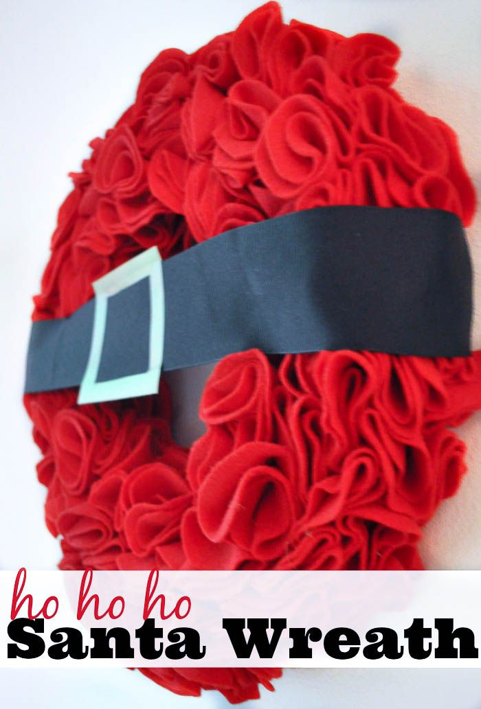 DIY Santa Wreath - A gorgeous ruffled felt wreath made to represent Good Old Saint Nick! Anyone can make this DIY Christmas Decor! | The Love Nerds