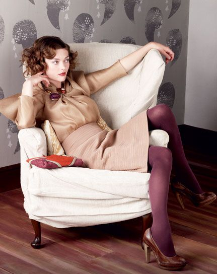 Love the camel colored dress and plum tights