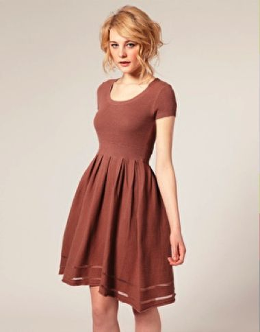 Love the silhouette on this simple but form flattering dress and the see through hem is a great touch!!