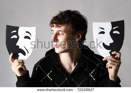 Young Man Holding Two Emotion Theater Masks, Looking On Sad Mask ...
