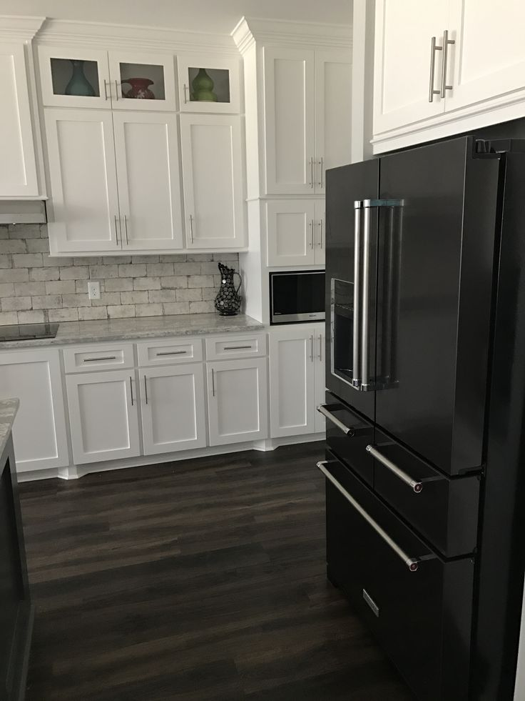 Best 25+ Black appliances white cabinets ideas on ...