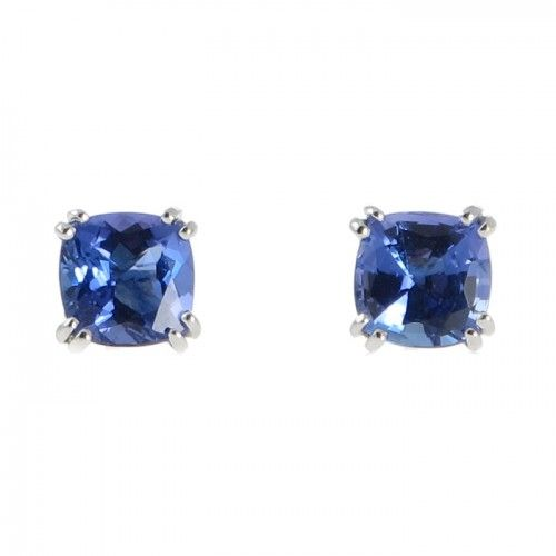 A pair of 18ct white gold earrings featuring a pair of cushion cut tanzanites totaling 3.33ct each set in four fine double claws that taper down the railed gallery to meet the stud and post fittings at the back. #Rutherford #Melbourne