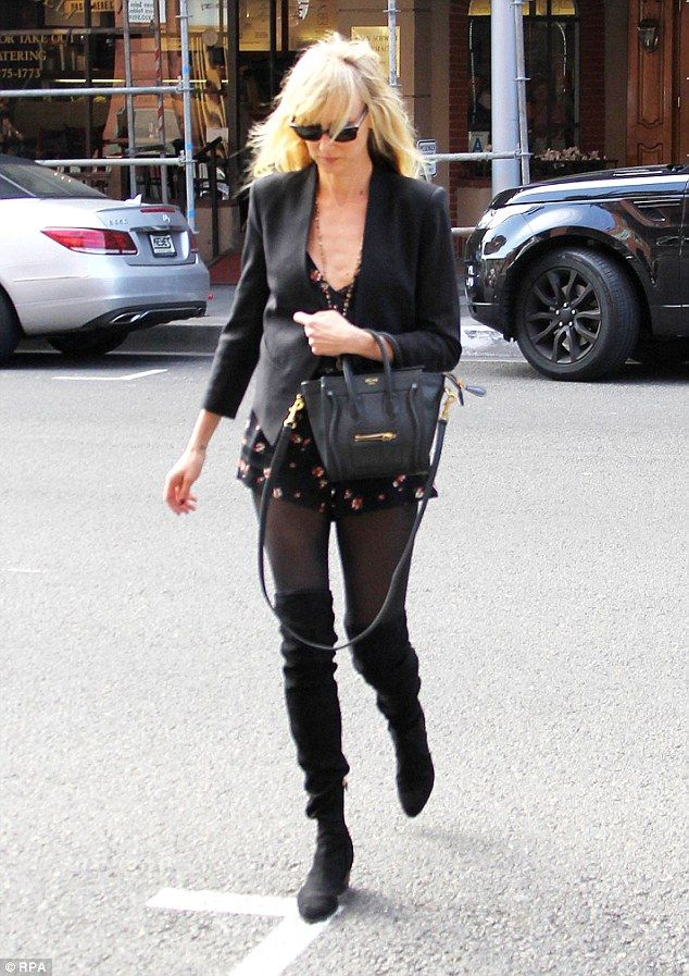 Kimberly Stewart shows off her slim figure in leather on schoolrun #dailymail