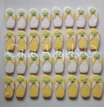 Yellow and White Jandal Cookies for a Hawaiian themed Wedding.