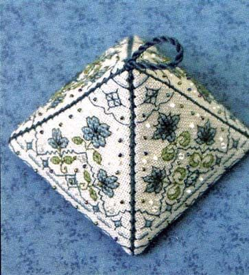 """The Pretty Pyramid I - Tiny Bleuettes Kit is a sweet, pyramid-shaped ornament, featuring decorative stitches in various hues of blues and greens. Finished size measures about 3"""" x 3"""".  All the supplies are included in the kit, so grab your needles, and lets start stitching this delightful project!"""