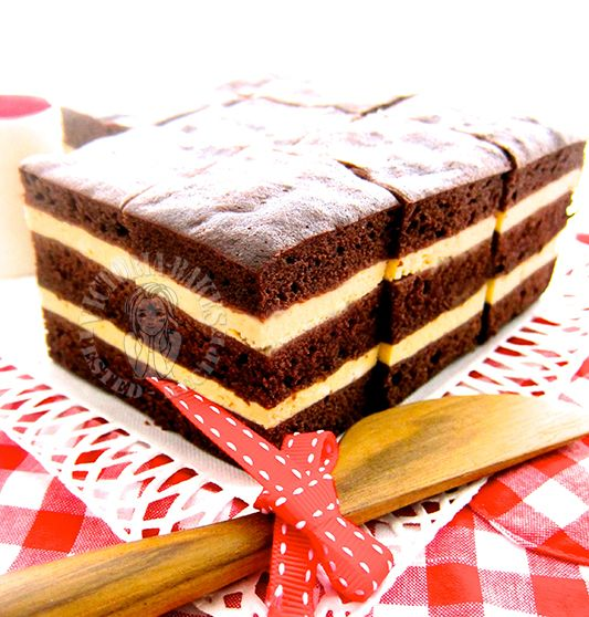 Ingredients (makes a 6 inch square cake with removable base) A 120g butter, softened 86 sugar B 144g egg 1 tsp vanilla extract 108g milk C 152g self rising flour 28g cocoa powder D (cream cheese la...