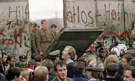 The fall of the Berlin Wall. A group of East Germans watch the wall come down, and they must surely know that East Germany's days are numbered.