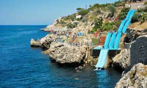 Slide into the Mediterranean Sea at one of the world's coolest water slides - Posted on Roadtrippers.com!