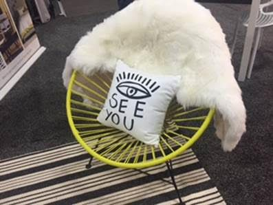 Give your Acapulco chair a hint of your own charm by accessorizing it with fur and a funky pillow.