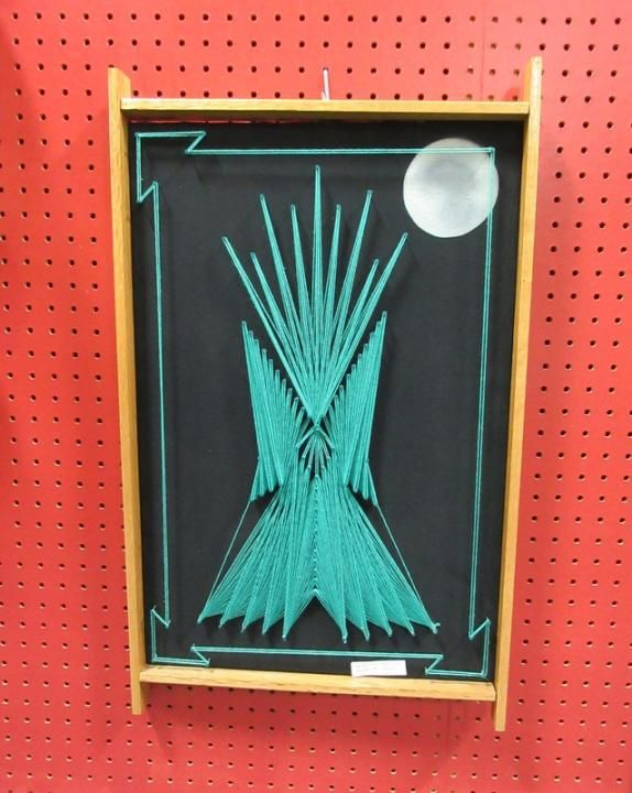 Southwestern inspired string art from Vendor 813 in booth 113. Priced at $39.00.  Aircraft parts desk lamp from Vendor 314 in booth 38. Priced at $299.00. ~ The Brass Armadillo Antique Mall in Denver, CO ~