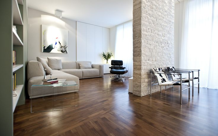 varnished wooden floor and stone wall