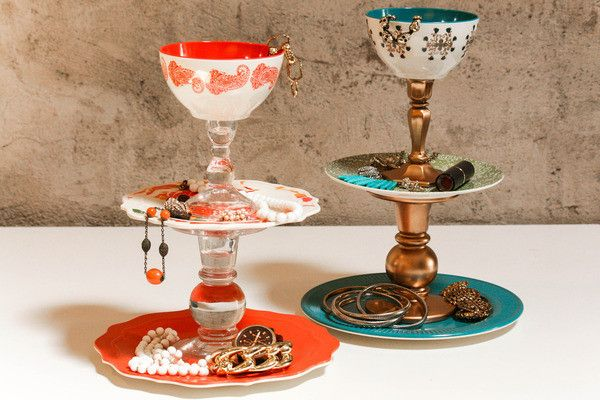 Spray paint old candlestick holders and glue them to plates and bowls for an instant tiered jewelry tray. #DIY
