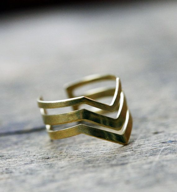 A triple chevron ring, very comfortable and lightweight, adjustable, fits all. You will find other rings from this collection in our shop (section