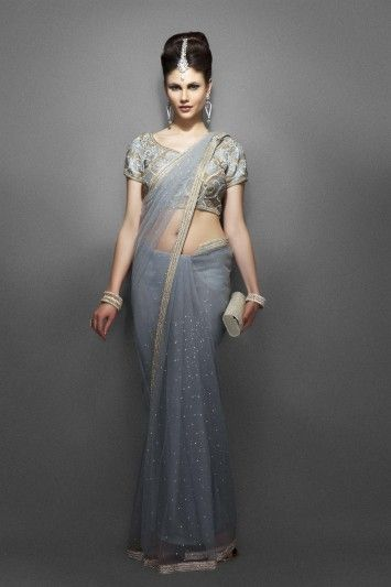 Grey net sari with heavy blouse