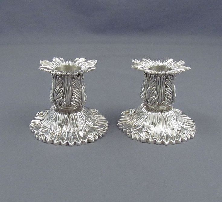 A pair of Tiffany Chrysanthemum sterling candlesticks New York, c. 1960. Solid cast construction with detailed Chrysanthemum...