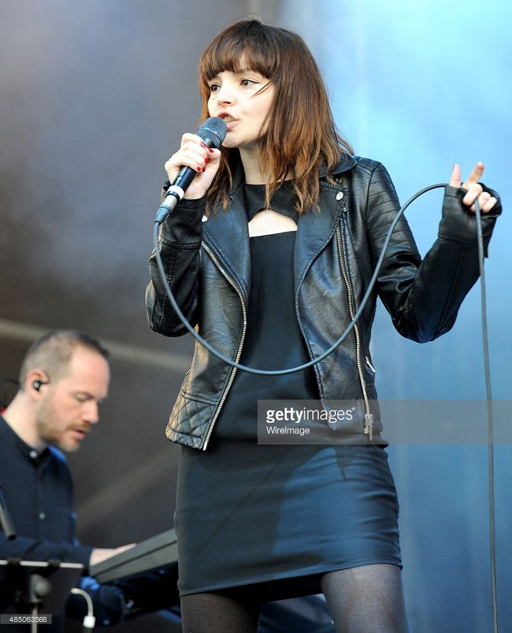 Lauren Mayberry and Iain Cook of Chvrches perform on Day 2 of the V Festival at Weston Park on August 23, 2015 in Stafford, England.
