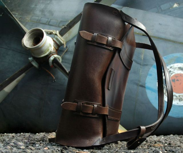 """really great design:  The Parachuter Bag recalls a bygone era, a time when you'd travel by steam ship accompanied by leather trunks.    Furniture designer Garvan de Bruir, inspired by traditional saddle-making, was trying his hand at making leather chairs without seams when he embarked on a """"personal and total immersion into leather."""""""