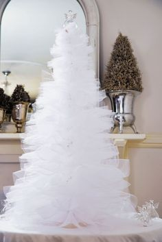 Try something different and make this white tulle Christmas tree this festive season.