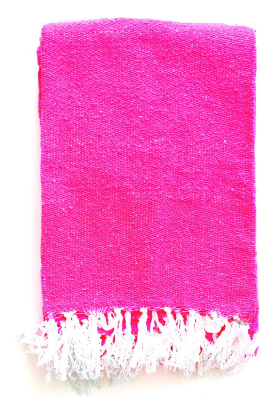 This is an authentic Mexican blanket in a solid neon hot pink color... perfect for the beach, picnic or as a bright home accent.Measures approximately 6'x4' Acrylic/Polyester/Cotton Blend Made in Mexico**Patterns and stitching may vary slightly due to handmade nature of this product.