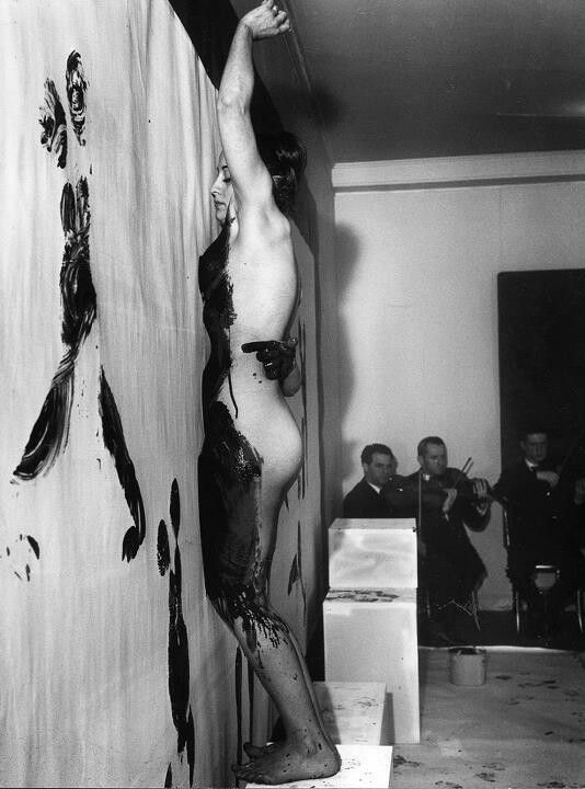 """One of Yves Klein's """"Anthropometrie"""" performance pieces. The model would have been covered in paint with his signature International Klein Blue pigment. Of course, the painted canvas is left to us."""