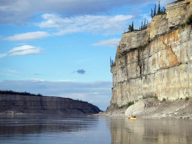 Dramatic cliffs along the Mackenzie River - one of 12 Great Canadian Canoe Trips
