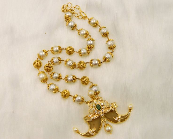South sea pearls mala and puligoru pendent