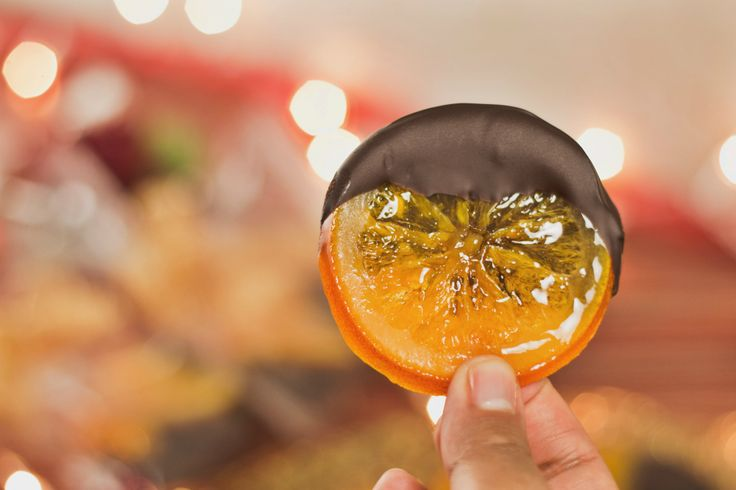 Candied Orange Slices-  1 navel oranges,1 1/2 cups water,     1 cup granulated sugar,4 oz dark chocolate.   Wash slice thin. Boil syrup, add slices, boil lightly 15 min flip boil other side until they become translucent. Lay out to dry. - Tastemade